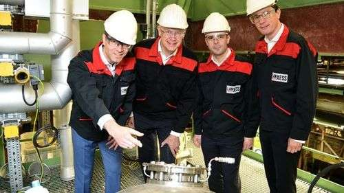 From left to right: Plant manager Axel Lache, member of the Board of Management and Labor Director Rainier van Roessel, Vice President of the Colorant Additives Business Dominik Risse and the head of the LANXESS Rhein Chemie business unit Philipp Junge inspect a new boiler of the expanded Macrolex production facility. Photo: LANXESS AG